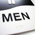 Men Washroom Door Sign Close Up